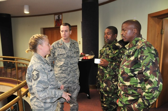 UMBUTFO, Swaziland - Air Force Master Sgt. Victoria Ashley-Manning and Maj. Kevin Hachmeister, members of the 920th Aeromedical Staging Squadron, Patrick Air Force Base, Florida, talk with soldiers from the Umbutfo Swaziland Defence Force (USDF) during a medical exercise at the USDF Headquarters in Manzini, Swaziland, August 3, 2009. MEDFLAG is a joint and combined military exercise led by U.S. Army Africa in support of U.S. Africa Command to improve medical disaster preparedness and humanitarian assistance management.