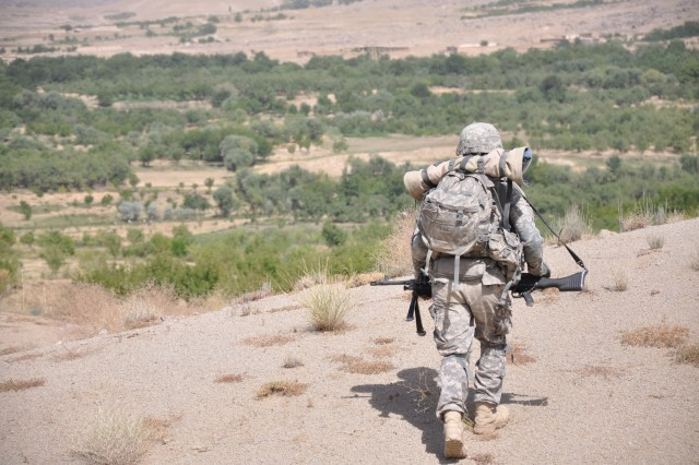 A 1st Battalion, 4th Infantry Regiment, Soldier descends a hill during a foot patrol, July 27, to speak with village leaders in Deh Chopan district, Zabul province.