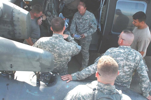 SOTO CANO AIR BASE, Honduras - Army Chief Warrant Officer Kyle Cheeseman gives a pre-flight briefing to members of the 1st Battalion, 228th Aviation Regiment here today prior departing to Nicaragua. The Blackhawk crew, along with two other helicopters assigned to Joint Task Force-Bravo, will support the hospital ship USNS Comfort's humanitarian and civic assistance mission in Nicaragua. (U.S. Air Force photo by Staff Sgt. Chad Thompson).