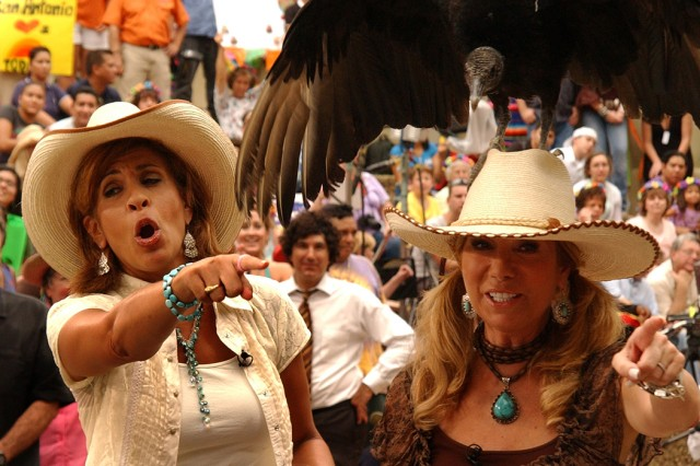 """Hoda Kotb points at Kathie Lee Gifford because she has a buzzard on her head July 29 during a segment of the """"Today"""" show. Soldiers from G Company, 232nd Medical Battalion, Fort Sam Houston, were invited take part in the show, riding on a river boat on the San Antonio River Walk."""