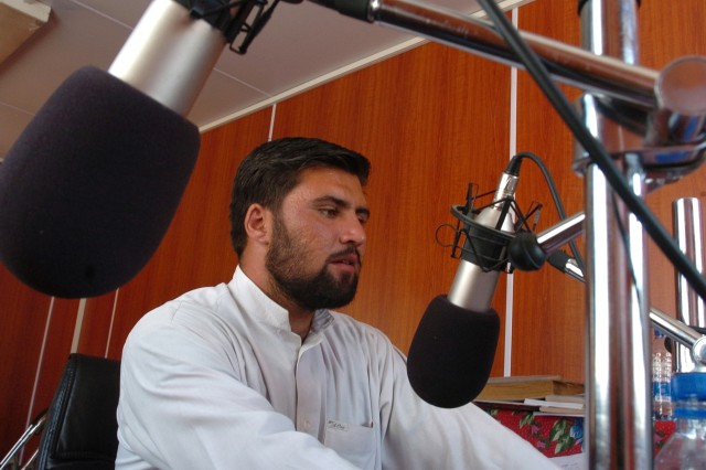 Shaib Dad Hamdard reaches out across Nuristan province, Afghanistan, on Kalagush Radio, Aug. 3. The International Security Assistance Forces funded station offers the people of the remote mountain area a variety of news and entertainment programs.
