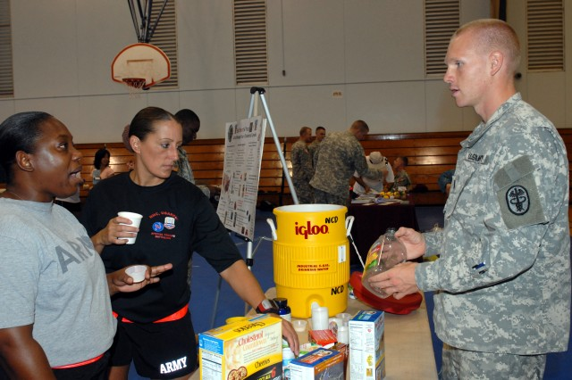 FORT SHAFTER, Hawaii - (August 7, 2009) Lt. Ben Wunderlich, outpatient dietician chief at Tripler Army Medical Center, presents ways to lower cholesterol to Capt. Mara Eck and Sgt. 1st Class Michelle Fairley, USARPAC Office of Protection Directorate.