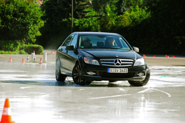 Sgt. Michael Lynch performs a J-turn on a slick surface with a Mercedes-Benz during the Anti-Terrorism Evasive Driving (ATED) Course. The ATED Course is designed to train Soldiers who are drivers and personal security detail for VIPs throughout Europe and Northern Africa. Performing a J-turn on the slick surface is the 'walk' phase of a 'crawl, walk, run' method used to train the Soldiers.