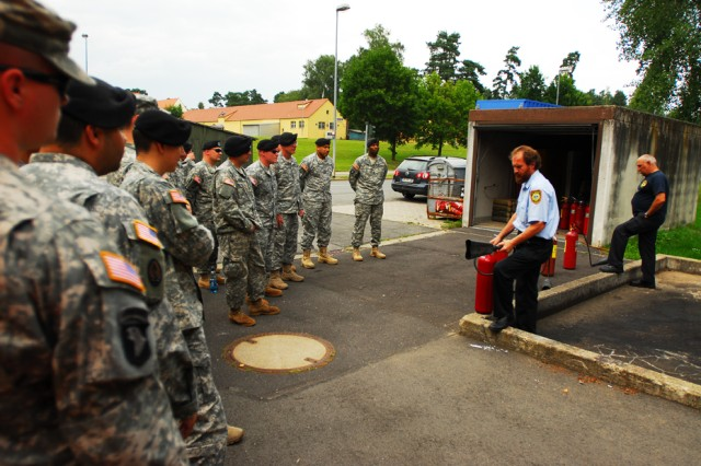 Otto Sperber, a fire inspector at the Vilseck Fire Station, instructs Soldiers on how to operate fire extinguishers carried on vehicles transporting hazardous materials throughout Europe. The regulations for transport of hazardous materials differ greatly between the United States and Europe; therefore German fire officials assist U.S. Soldiers undergoing a series of courses aimed at providing them with the skills to keep European locals safe.