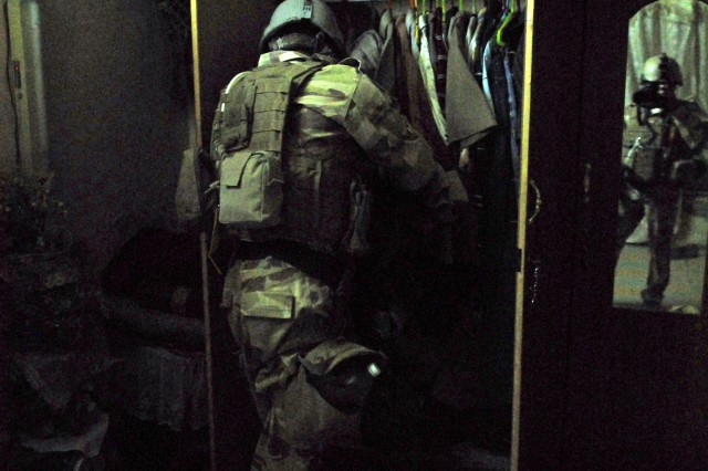 An Iraqi Special Operations Forces Soldier in the 1st Brigade's media department snaps a photo during a night-time mission in Baghdad July 13. The seven-man department stood up in late 2007.