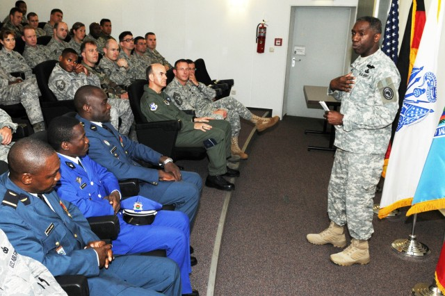 "Gen. William ""Kip"" Ward, commander of U.S. Africa Command, speaks with members of the 17th Air Force (U.S. Air Forces Africa) after visiting their newly remodeled Ramstein Air Base headquarters, Aug. 11, 2009. Also in attendance were three military officers from Burkina Faso, who were participating in a week-long familiarization course on base security."