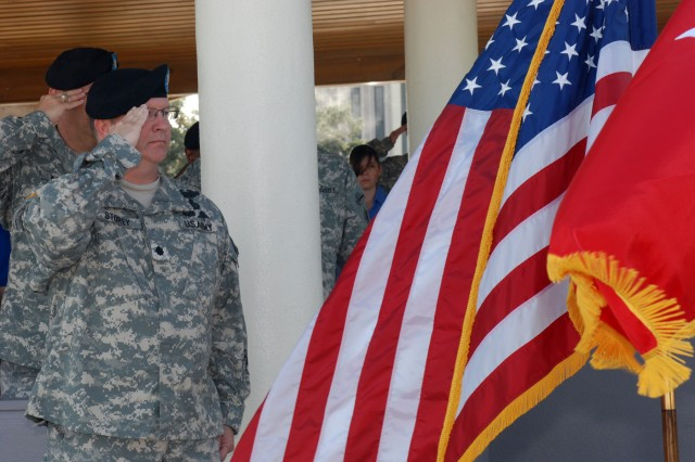 Lt. Col. Scot Storey, U.S. Army South Special Troops Battalion commander, salutes the colors during an activation ceremony at MacArthur Field Aug. 11. The ceremony officially marked the activation and assumption of command of Headquarters and Service Company, A Company and B Company, Special Troops Battalion in U.S. Army South.