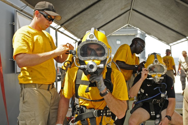 Divers from the 86th Engineer Dive Team go through an equipment check, prior to diving, aboard an Army Landing Craft Utility vehicle in the Persian Gulf, Aug. 9.