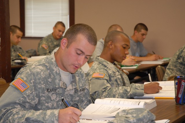 Pfc. Daniel McAfee, left, and Pvt. Ishmael Dixon, work math exercises while in class at the Army Preparatory School. The school assists Soldiers with earning their GEDs. About 55 Soldiers rotate through the program each week.