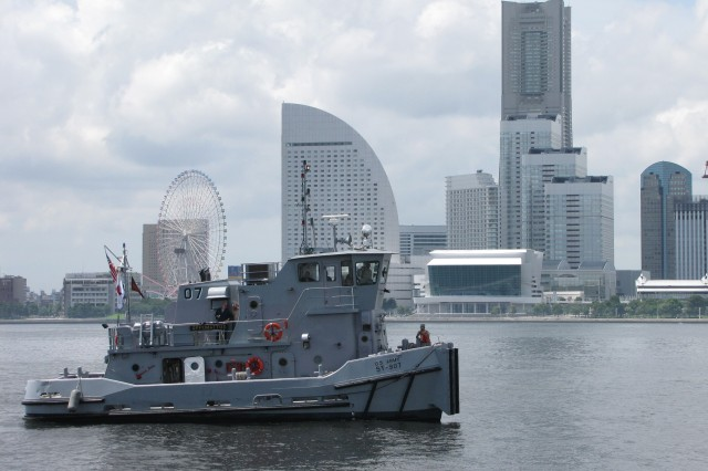 An Army tug boat gets underway in Yokohama harbor during Exercise Pacific Reach 2009 in Tokyo, Japan. Soldiers took the watercraft out of the Army's pre-positioned set to perform maintenance and inventory, preparing the equipment for future missions.