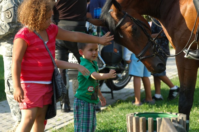 Children from the Hedielberg community pet a horse ridden by German Polizei during the National Night Out event held on Patrick Henry Village in Heidelberg Aug. 4. The event was designed to draw residents out of their apartments and bring them together to explore garrison and local national emergency response equipment and to become better acquainted with one another.