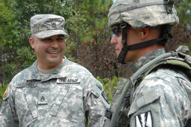 Staff Sgt. Juan Hernandez speaks with a Soldier at Argentin Range, where he was serving as range safety officer.