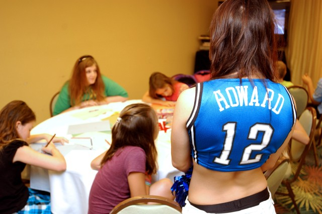 Orlando Magic Dancer Erin Gomerall watches young girls play during a recent visit to the 81st Regional Support Command's Yellow Ribbon Reintegration Program held in Orlando Aug. 7-9. More than 75 sons and daughters of Soldiers who recently returned from combat tours in Iraq and Afghanistan were signed up for the child care program designed to entertain the Army Reserve youth as their parents were busy learning how to reintegrate back into their families and communities after a deployment overseas.