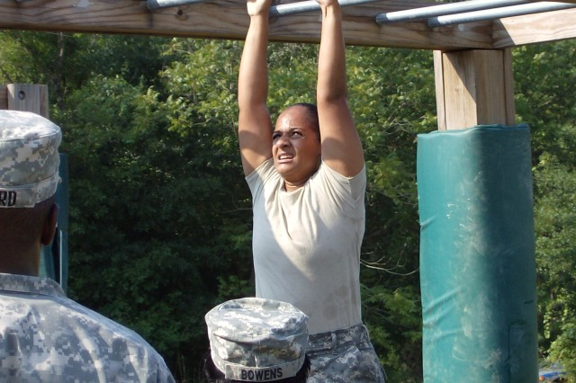 Sgt. 1st Class Angela Indardeo navigates the horizontal ladder on the Fit to Win course as part of the Soldier Support Institute NCO of the Year competition. Indardeo, was named the organization's NCO of the Year and Spc. Bobby Bonner was named Soldier of the Year.