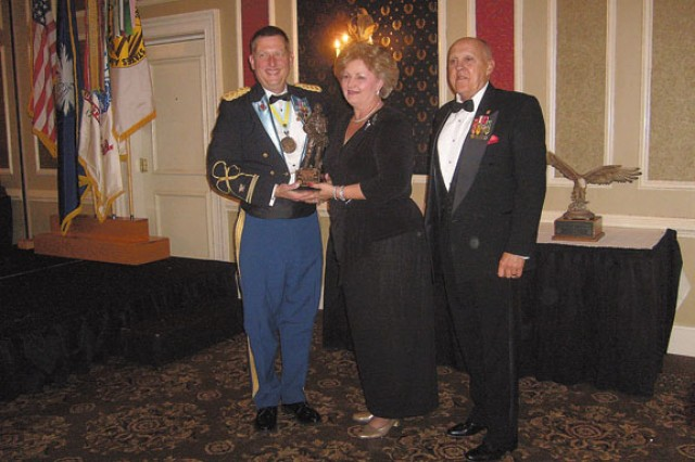 Silvia Butler is the installation transportation officer and chief of the transportation division in the Directorate of Logistics. She is shown here receiving an award from the Association of the U.S. Army.