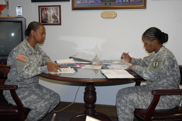 Command Sgt. Maj. Darlene Hagood, shown here with her assistant Sgt. 1st Class Shonda Harrington, is the first female regimental sergeant major for the Adjutant General's Corps. She is responsible for the more than 40,000 enlisted Soldiers in the