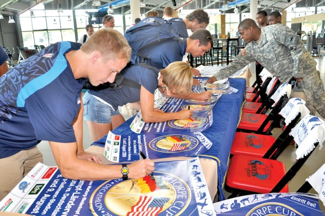 Members of the U.S. National Track and Field Team sign autographs during a visit to the U.S. Army Garrison Wiesbaden Fitness Center Aug. 6.