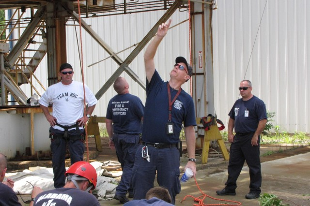 Jeff Burns, one of three instructors in last weekAca,!a,,cs Redstone Arsenal rope rescue class, briefs the students at an old NASA test stand.