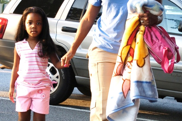 Karen Twitty walks her daughter, Brooke, 4, to her first day of school at the Child Youth Center Aug. 10. Brooke's father and Karen's husband is Col. Stephen Twitty, U.S. Army Central chief of staff.