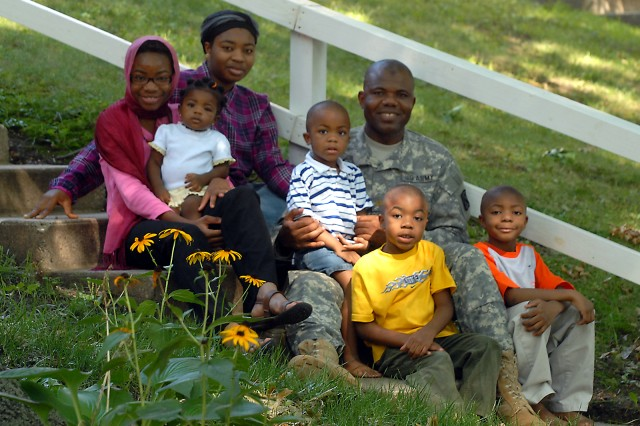 Chaplain (Maj.) Dawud Agbere with his family outside of their home in Normandy Village, Aug. 11, on Fort Leavenworth, Kan.