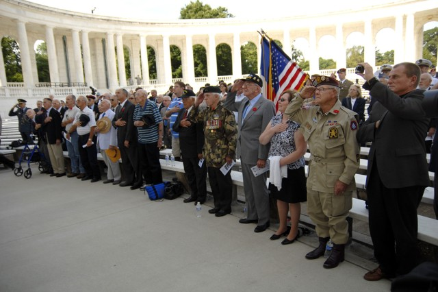 More than 20 veterans from Operation Dragoon, the Allied invasion of southern France, salute during the playing of the national anthem. Most of the morning was spent commemorating the operation, which took place in August of 1944, and along with the invasion at Normandy, helped turn the tide to the Allies' favor.