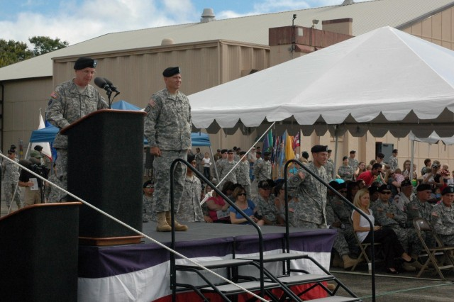 "Brig. Gen. Michael J. Terry (left), commander, 8th Theater Sustainment Command, speaks to Soldiers, families and friends during the 25th Combat Aviation Brigade's (CAB) deployment ceremony at Wheeler Army Airfield, Aug. 10. Col. Mike Lundy, commander, 25th Combat Aviation Brigade (CAB), also provided words of inspiration as he spoke before the casing of the unit's colors. The 25th CAB will assume responsibility for aviation operations in northern Iraq as part of Task Force ""Marne."""