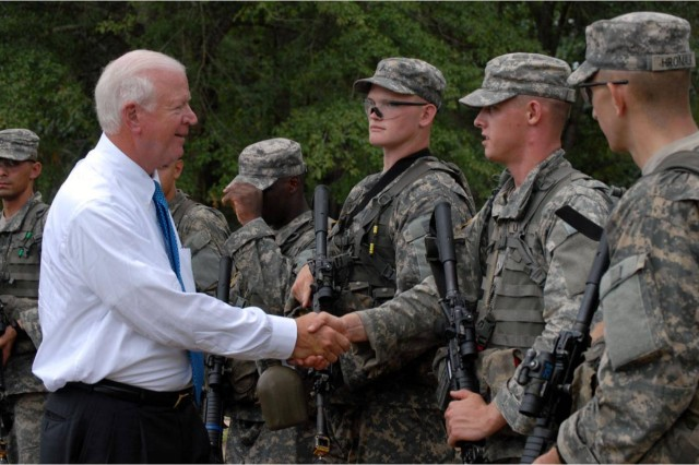 "Chambliss visited Cashe Town on Sand Hill Tuesday to observe training.  After observing the training, Chambliss shook hands with some of the Soldiers.  ""It makes me proud that you're Georgians and you're here for the right reasons.  We'll (make) a better America because of what you do."""