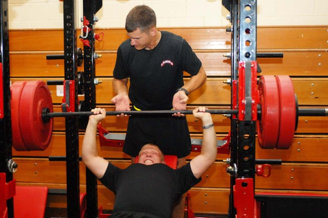 SPC Wayne Knapp bench presses weights as SGT Scott Roth spots him Tuesday at the Audie Murphy Athletic Performance Enhancement Center.  Both Knapp and Roth are with the 75th Ranger Regiment.  The gym is open to all valid military ID cardholders, and units can reserve the gym for training.