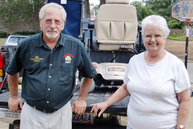 Retired 1st Sgt. Mike Craig, commander of the Veterans of Foreign Wars Post 5180, and Margaret Bosch stand in front of a truck loaded with electric wheelchairs. Bosch donated an electric wheelchair to the VFW for its project Operation Dust Off. The post has been collecting electric scooters for disabled veterans and their spouses since July.