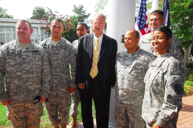 SGT Mathew Harvey (left) and LTC Sean Mulcahey (second from right), commander of Fort Benning\'s Warrior Transition Battalion, and other WTB Soldiers stand alongside U.S. Congressman Ike Skelton at Roosevelt Warm Springs Institute for Rehabilitation during a dedication ceremony Aug. 3.