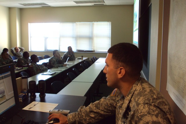 Staff Sgt. Richard Fiorucchi, of 1-501st Infantry Battalion, 4th Brigade Combat Team (Airborne), 25th Infantry Division, explains a topic to students during an Individual Readiness Training class.