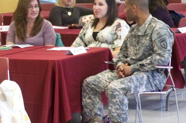 Sgt. 1st Class Malik Kaiser, 725th Brigade Support Battalion rear detachment first sergeant, talks to his Family Readiness Group leaders during  a Volunteer of the Month ceremony.