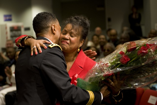 Lt. Gen. Dennis Via hugs his wife Linda during his promotion ceremony at the Pentagon in Arlington, VA., on Aug 14, 2009.