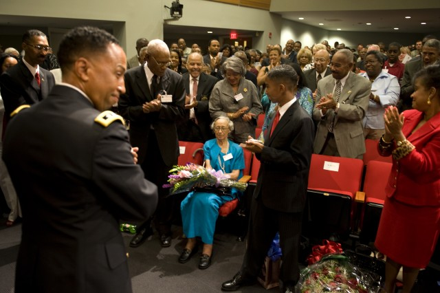 Lt. Gen. Dennis Via presents flowers to his mother during his promotion ceremony at the Pentagon in Arlington, VA., on Aug 14, 2009.