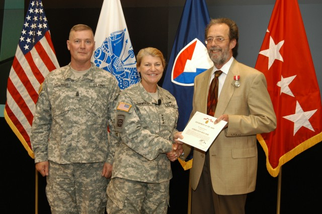 Dana Burrows retires, is honored for his 35 years of service and receives the Superior Civilian Service Award.