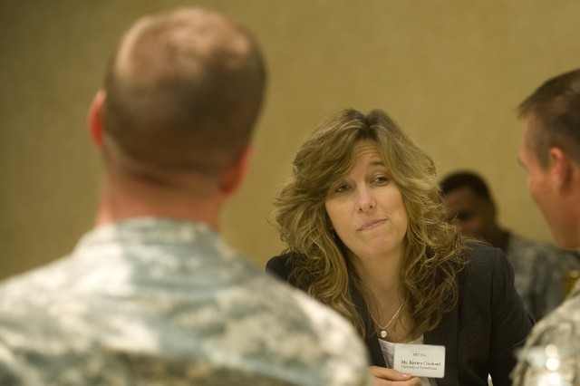 """Kristen Cronland, University of Pennsylvania teacher and facilitator, listens to Soldiers during a break out session of the pilot class for Army """"Master Resiliency Trainers""""  in Philadelphia, Pa., on Aug. 15, 2009. The class is in support of a new Army program called """"Comprehensive Soldier Fitness"""" that is being developed to provide Army families, civilians and Soldiers better mental fitness resources."""