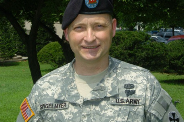U.S. Army sergeant major helps man from mangled car