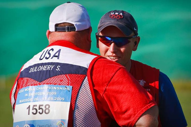 MARIBOR, Slovenia--Sgt. 1st Class Shawn Dulohery, U.S. Army Marksmanship Unit, congratulates teammate and fellow USAMU Soldier Spc. Vincent Hancock after Hancock completes a perfect final round score of 25 Aug. 16 in the Men's Skeet finals. Hancock won gold at the 2009 International Sport Shooting Federation World Championships a year to the day when he won Olympic gold in China. (Courtesy photo)