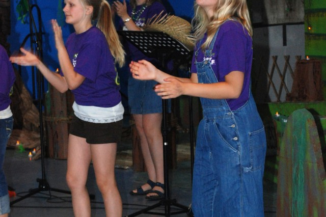 """Volunteers lead children in worship songs at the """"bayou"""" during the Patch Barracks VBS in July."""