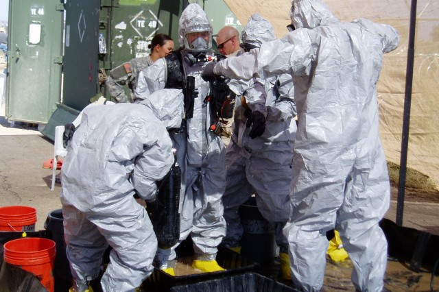 Decontamination activities were a daily part of life for the 20th Support Command Chemical Biological Radiological Nuclear and High-Yield Explosives Analytical Remediation Activity when they were in Taji, Iraq. Camped near one of Saddam Hussein's chemical schools, the unit was tasked with deposing of approximately 2,400 empty liquid rockets found randomly buried on the site.