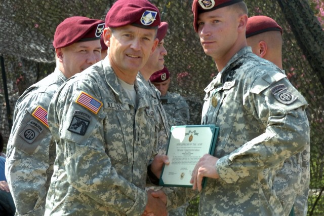 Maj. Gen. Daniel Allyn, XVIII Airborne Corps and Fort Bragg deputy commanding general congratulates Sgt. Donald Kuehner, Company D, 2nd Battalion, 508th Parachute Infantry Regiment, 4th Brigade Combat Team, 82nd Airborne Division Friday after presenting him with the Army Commendation Medal with V Device at Fury Field. Kuehner earned the medal for his actions in Afghanistan on Oct. 14, 2007.