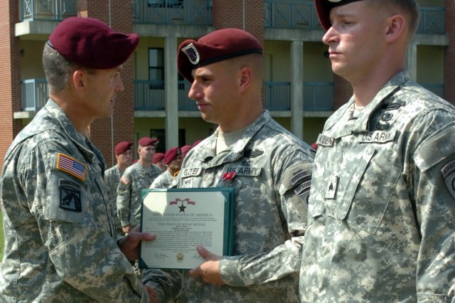 Maj. Gen. Daniel Allyn, XVIII Airborne Corps and Fort Bragg deputy commanding general congratulates Staff Sgt. Ryan Gloyer, Company D, 2nd Battalion, 508th Parachute Infantry Regiment, 4th Brigade Combat Team, 82nd Airborne Division after presenting him with the Bronze Star Medal with V Device Friday at Fury Field. Gloyer was recognized for his actions in Afghanistan on July 25, 2007. Sgt. Donald Kuehner, right, earned the Army Commendation Medal with V device for his actions Oct. 14, 2007.
