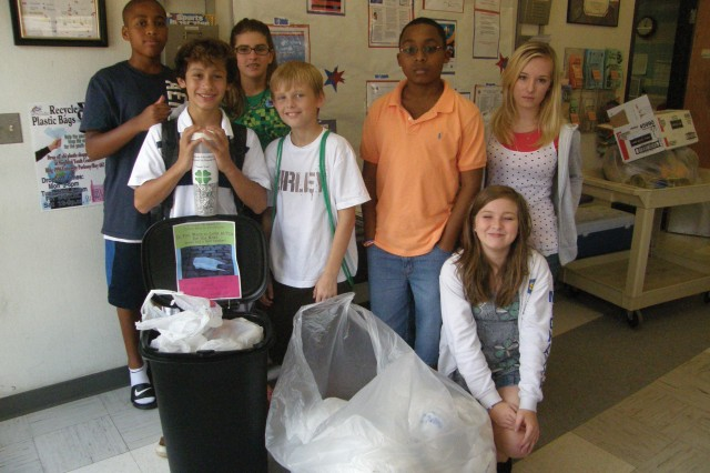 These Fort Polk Child, Youth and School Services middle school teens participate in the recycling program. Back row: Phillip Hilaire and Christine Bobak. Front row: Christian Baer, Chephren Branconier, Kendrick Washington and Shawne Gage. Kneeling is Michayla Cluette.