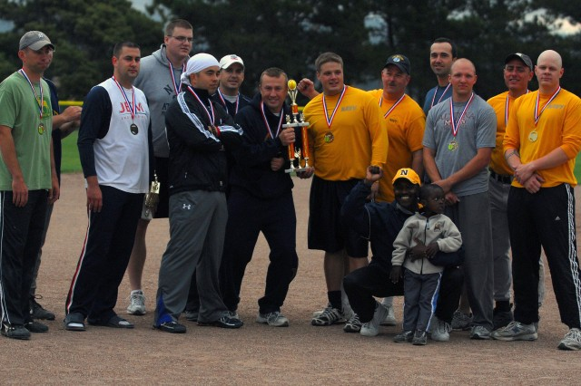 Navy softball team members show off their first place trophy after winning the Presidio's Intramural Softball championship. PHOTO/PETTY OFFICER 2ND CLASS STEVEN L. SHEPARD, USN