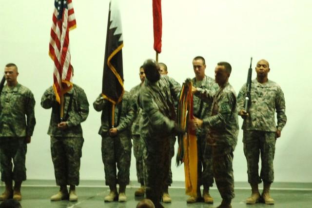 Col. Daniel L. Karbler and Sgt. Maj. Johnny C. Woodley uncase the 31st Air Defense Artillery colors symbolizing the acceptance of the Central Command Patriot mission.
