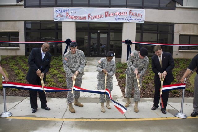 The grand opening and ribbon cutting at Anniston Army Depot, Ala., for its Powertrain Flexible Maintenance Facility was Aug. 12. From left to right, AFGE President Everett Kelley, Col. Byron Jorns with the Army Corps of Engineers-Mobile District, Depot Commander Col. S. B. Keller, TACOM Commanding General Maj. Gen. Scott West, and U.S. Rep. Mike Rogers.