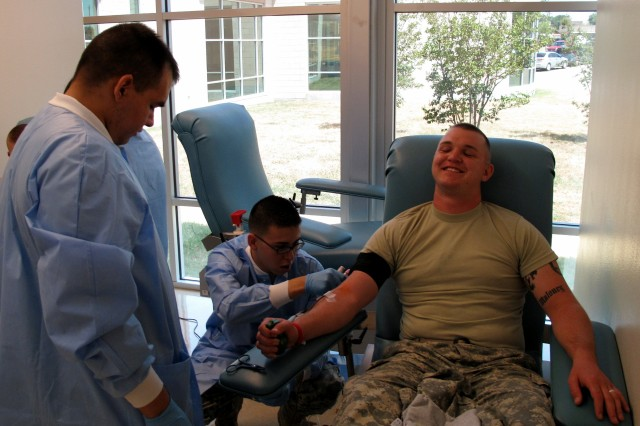 (L-R)  Spc. Pfc. Jeffrey Maloney, a heavy equipment operator at Robertson Blood Center, Fort Hood, Wednesday, July 08, 2009.