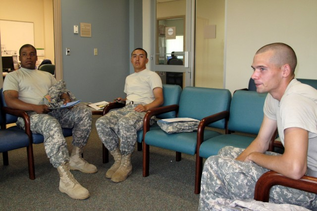 (L-R):  Pvt. Michael Royal, a light wheeled vehicle mechanic; Pvt. Francisco Saludado, a cook; and Pf. Harold Regan, a heavy construction equipment operator wait for a private interview at the Robertson Blood Center, Fort Hood on Wednesday, July 08, 2009.