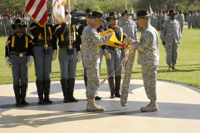 "Col. Philip Battaglia, the outgoing commander of the 4th Brigade Combat Team, 1st Cavalry Division ""Long Knives"" and Command Sgt. Maj. Edwin Rodriguez, the senior enlisted Soldier for the Long Knife Brigade, uncase the unit's colors during the change-of-command ceremony at Fort Hood's 1st Cav. Div. Headquarters Aug. 6."