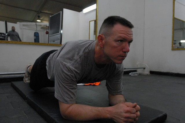 BAGHDAD - Sgt. Brian Normand, of Company A, Division Special Troops Battalion, 1st Cavalry Division, performs a prone plank exercise at Victory Base Complex, here, Aug. 10. The Mesquite, Texas native is performing physical therapy exercises to strengthen his lower back as prescribed by medical personnel to get him back to full strength.